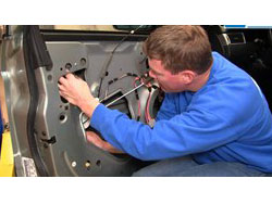 Technician Working on Power Window Repair